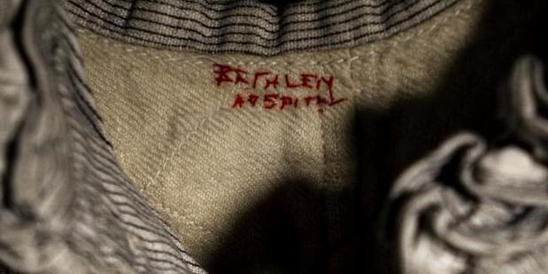 Bethlem stitched into the lining of a straight jacket in a picture by Jane Fradgley from 2012.
