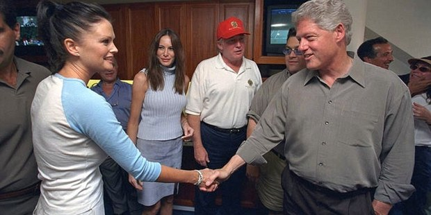 Model Kylie Bax shakes hands with former US President Bill Clinton as Donald Trump and wife, Melania, look on in the background. Photo / Politico-Daily Mail