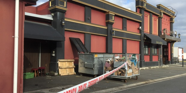 A staff member at Hamilton's Cock & Bull was held up at gunpoint last night. The rear of the building was cordoned off by police this morning. Photo / Belinda Feek