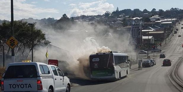 Fire takes hold in a Go Bus Transport bus in Stuart St yesterday. Photo / Supplied via Otago Daily Times