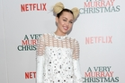 Miley Cyrus says walking a red carpet is like being in some kind of comedy skit. Picture / AP