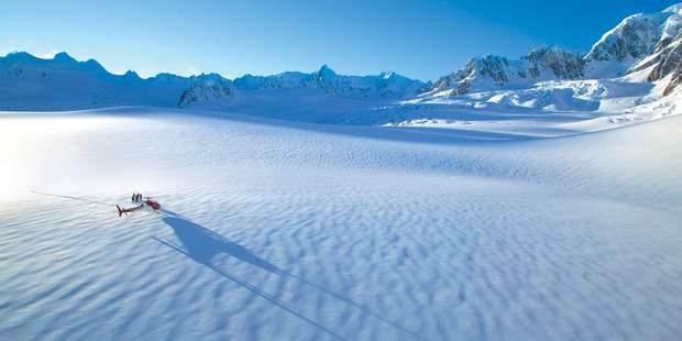 A helicopter landing on Franz Josef Glacier where Skyline Enterprises has plans to build a gondola