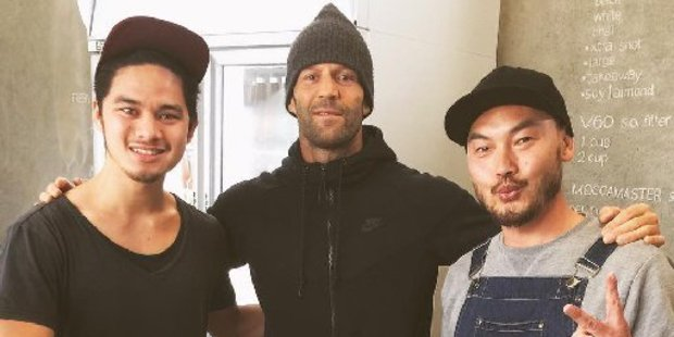 Hollywood actor Jason Statham visited the Cup and Bun cafe in Grey Lynn this morning, 16th September 2016. Pictured with cafe owner Andy JV , L and Jharaiz.