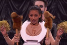 Sam Wills, aka Tape Face, hangs a toilet seat over the head of America's Got Talent judge Mel B. Photo/YouTube