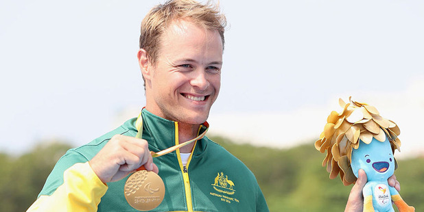 Curtis McGrath of Australia poses on the medals podium after winning the men's KL2 final at Lagoa Stadium. Photo / Getty
