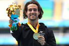 Liam Malone celebrates with his gold medal after victory in the men's 400m T44 final. Photo / Getty