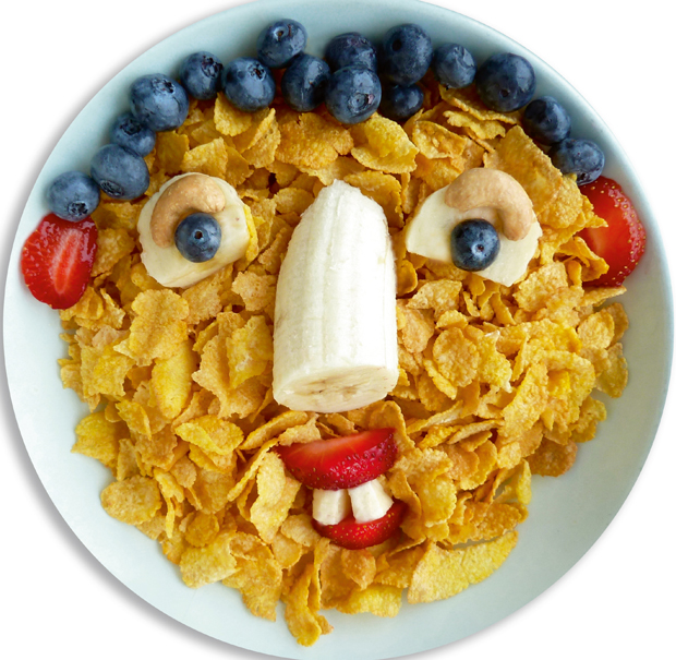 """""""Flakey"""": Cornflakes, banana, blueberries, strawberry and cashews. Photo / Copyright Funny Food Made Easy by Bill and Claire Wurtzel, Welcome Books, 2016 via Washington Post"""
