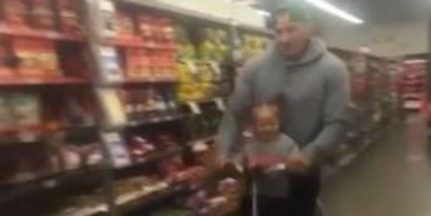 Loading Sonny Bill whizzes through the supermarket with 1-year-old daughter Imaan. Photo / via Twitter