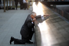 Robert Peraza, who lost his son Robert David Peraza, pausing at his son's name at the North Pool of the 9/11 Memorial. Photo / AP