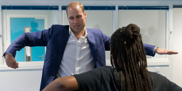 Prince William attempted to learn some dance move with the Scariofunk dance collective during a visit to Caius House Youth Centre in London. Photo / AP