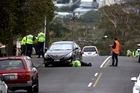 Police at the scene on Jaemont Ave, Te Atatu where a young child has been hit by a car. 22 September 2016. New Zealand Herald photograph by Dean Purcell