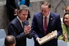 Colombia President Juan Manuel Santos presents a peace agreement to John Key at the United Nations headquarters in New York. Photo / AP