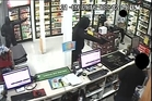 TERRIFYING: Security camera footage shows two of three robbers pointing firearms at workers at Whangarei Liquor Centre on Maunu Rd.