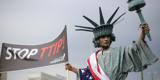 A man attends a demonstration against the planned Transatlantic Trade and Investment Partnership, TTIP, and the Comprehensive Economic and Trade Agreement, CETA in Berlin. Photo / AP
