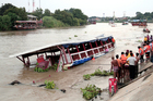 Thai rescue teams search for victims after a boat capsized at Chao Phraya River in Ayuthaya Province, Thailand. Photo / AP
