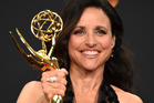 Julia Louis-Dreyfus shows off her statue for outstanding lead actress in a comedy series for Veep. Photo/AP
