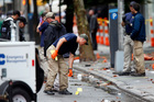 Evidence teams investigate at the scene of the explosion on West 23 Street in Manhattan's Chelsea neighbourhood. photo / AP