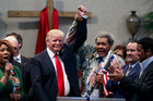 Boxing promoter Don King, right, holds up the hand of Republican presidential candidate Donald Trump at a rally in Cleveland, Ohio. Photo / AP