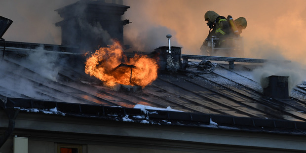 Firefighters try to extinguishing a fire at the Royal Institute of Art in Stockholm, Sweden. Photo / AP