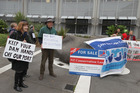 Some of the protesters outside the Hawke's Bay Regional Council, Napier. PHOTO/DUNCAN BROWN