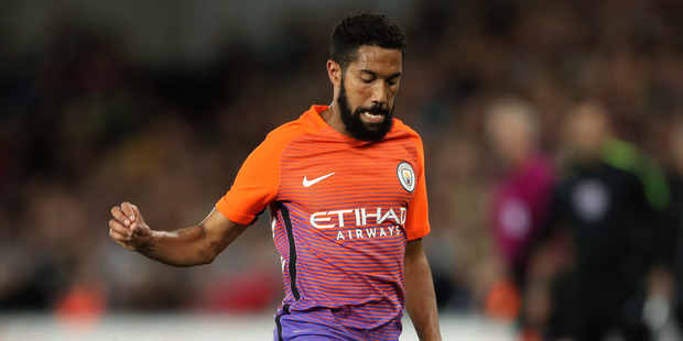 Manchester City fullback Gael Clichy sports Manchester City's controversial third kit in this morning's League Cup clash against Swansea City. Photo / AP
