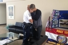 Officer James Poole was reunited with the boy he saved from a swimming pool nineteen years ago.