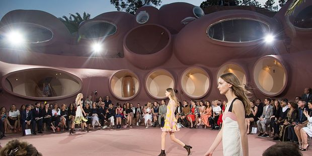 Models walk the runway during the Dior Croisiere 2016 at the 'bubble palace'. Photo / Getty