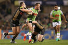 Josh Hodgson of the Raiders is tackled during the second NRL Semi Final match between the Canberra Raiders and the Penrith Panthers. Photo / Getty Images