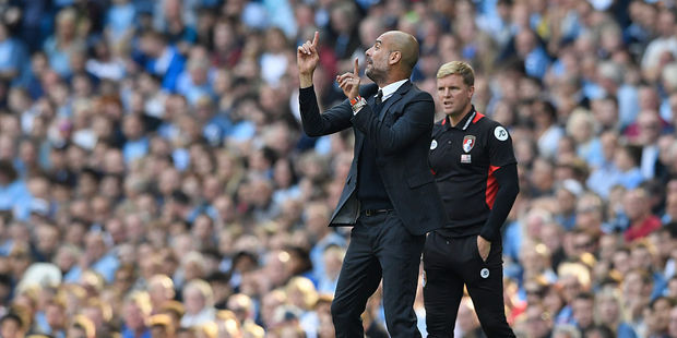 Pep Guardiola, Manager of Manchester City, gives his team instructions during the Premier League match between Manchester City and AFC Bournemouth. Photo / Getty Images