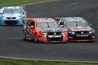Warren Luff and Paul Dumbrell battle for position at the Sandown 500. Photo / Getty Images