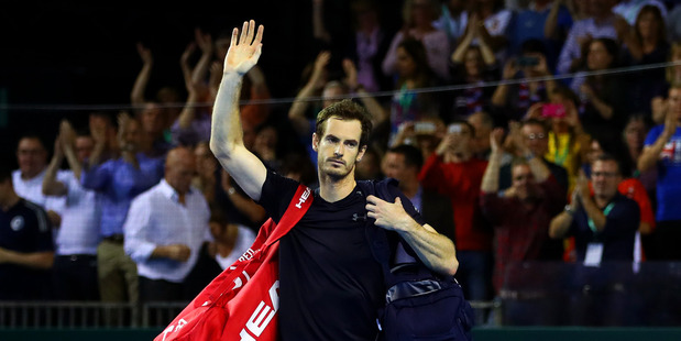 Andy Murray waves to the crowd as he leaves the court following his Davis Cup victory. Photo / Getty Images