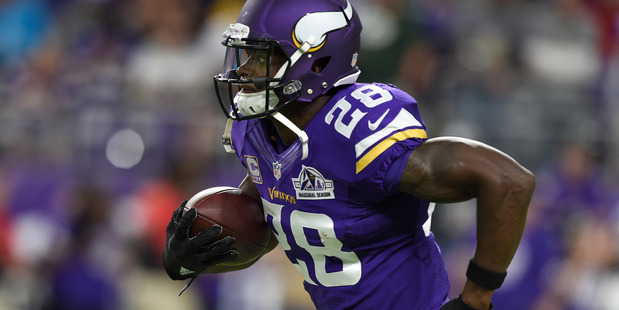 Adrian Peterson warms up prior to a game against the Green Bay Packers. Photo / Getty Images
