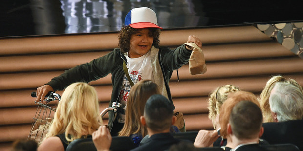 Stranger Things star Gaten Matarazzo passes out snacks at the Emmys. Photo / Getty Images.