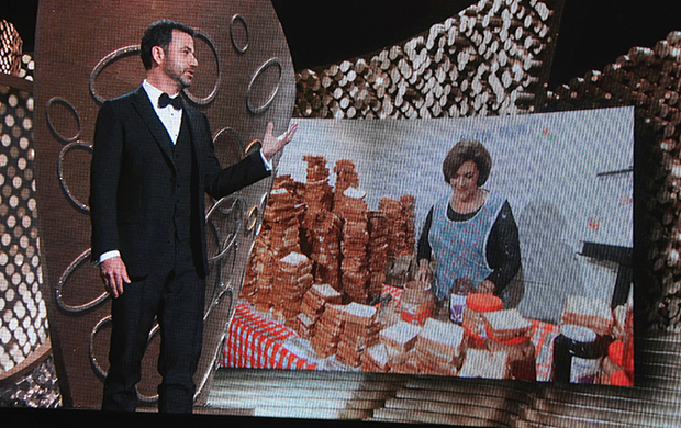 Host Jimmy Kimmel speaks to mother Joann Iacono as she makes peanut butter and jelly sandwiches for the audience during the Emmy Awards. Photo / Getty Images