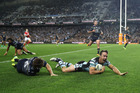 James Maloney of the Sharks scores a try during the preliminary final match against the Cowboys. Photo / Getty