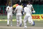 India's captain Virat Kohli, left, celebrates the wicket of New Zealand's Luke Ronchi. Photo / AP