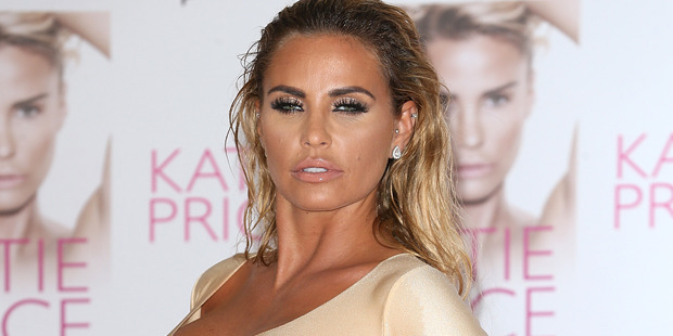 "Katie Price unveils her new Book ""Reborn"" by emerging from an egg. Photo / Getty"