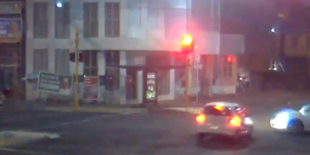 Loading The video, which shows a car rushing through the intersection of Karo Drive and Victoria St about four seconds after the traffic light turned red, has been shared on social media.
