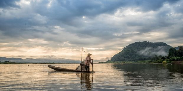 Fishing on Mekong river. Photo / 123RF