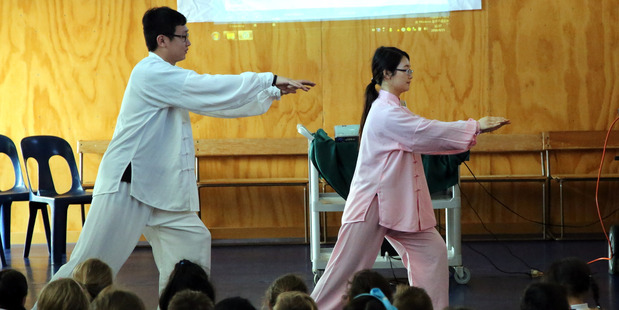 Chinese teachers Ming Ma (left) and Tory Shi demonstrate tai chi for students at St Marcellin School.PHOTO/STUART MUNRO