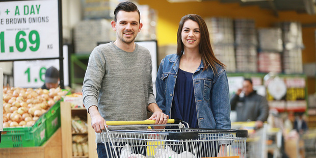 Loading Pedro and Hannah Miller worked to keep their grocery budget for the week under $28.50. Photo/Doug Sherring