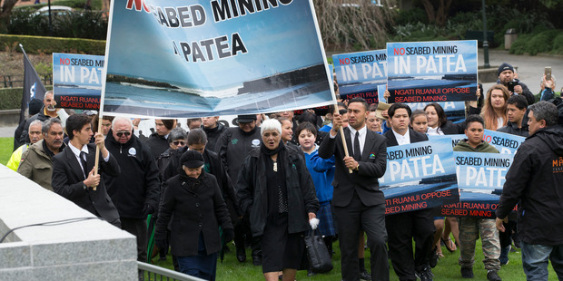 Loading Ngati Ruanui iwi arriving at Parliament to present a 6000 signature petition opposing seabed mining. New Zealand Herald photograph by Mark Mitchell.