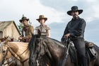 Luke Grimes, Haley Bennett and Denzel Washington in a scene from the film, The Magnificent Seven.