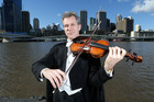 Stephen Phillips played violin for the Queensland Symphony Orchestra. Photo / News Limited