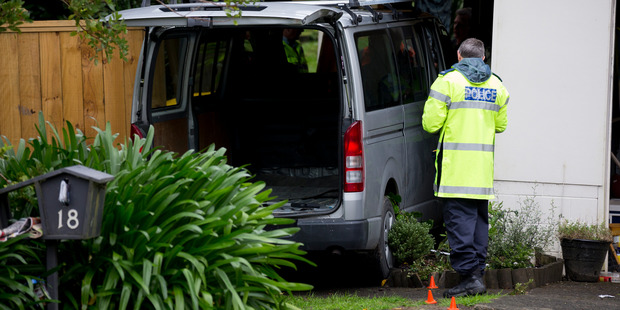 Firefighters worked for around 30 minutes to free the man, after he became trapped between a van and a house on Bonito Place, Bayview, on Auckland's North Shore. Photo / Dean Purcell