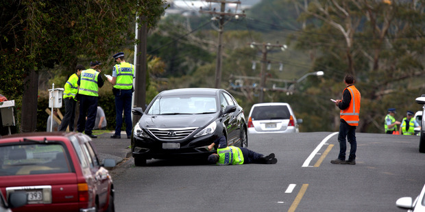 Loading Police at the scene on Jaemont Ave, Te Atatu, where a young child has been hit by a car. Photo / Dean Purcell