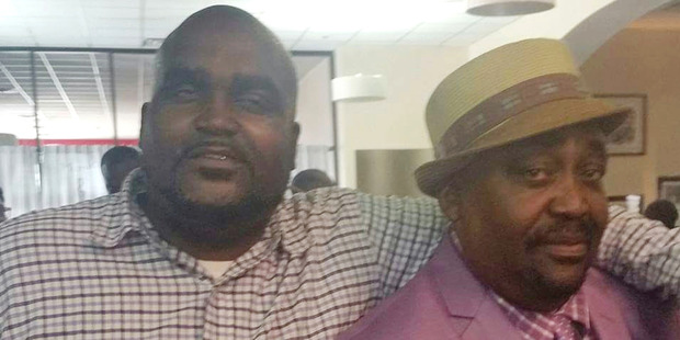 Terence Crutcher, left, with his father, Joey Crutcher. Photo / AP