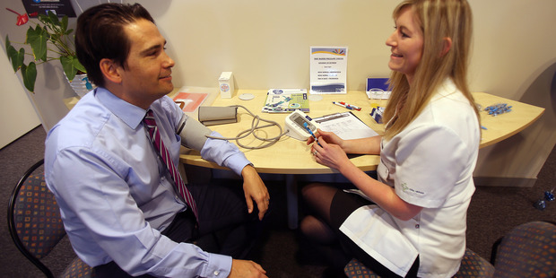 Simon Bridges gets his blood pressure checked. Photo/Andrew Warner
