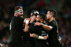 TJ Perenara of New Zealand is mobbed by teammates after scoring a try during the Rugby Championship match. Photo / Getty Images.