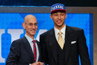 Ben Simmons poses for a photo with NBA Commissioner Adam Silver after being selected as the top pick by the Philadelphia 76ers in June. Photo / AP